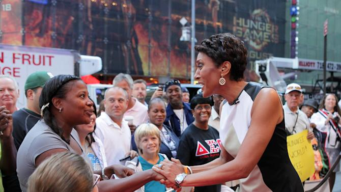"""This image released by ABC shows """"Good Morning America"""" co-host Robin Roberts, right, speaking with a fan outside on the popular morning show on Thursday, Aug. 30, 2012 in New York. Roberts has said goodbye to """"Good Morning America,"""" but only for a while. The """"GMA"""" anchor made her final appearance Thursday before going on medical leave for a bone marrow transplant. Roberts' departure was first planned for Friday, but she chose to exit a day early to visit her ailing mother in Mississippi. In July she first disclosed that she has MDS, a blood and bone marrow disease. She will be hospitalized next week to prepare for the transplant. The donor will be her older sister, Sally-Ann Roberts. (AP Photo/ABC, Fred Lee)"""