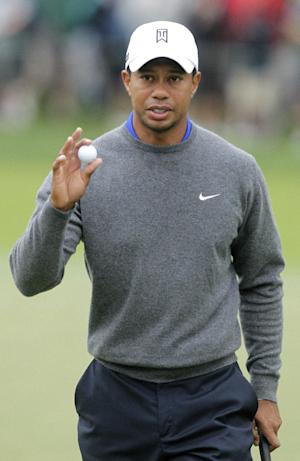 Tiger Woods waves to the crowd after making a putt on the first hole during the second round of the Memorial golf tournament Friday, June 1, 2012, in Dublin, Ohio. Woods birdied the hole. (AP Photo/Jay LaPrete)