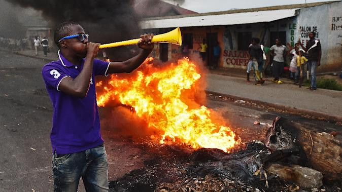 Protesters opposed to Burundian President Pierre Nkurunziza's  third term in office burn barricades during a demonstration in Cibitoke