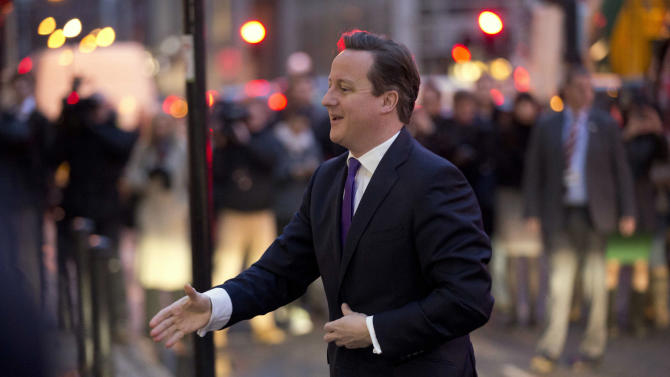 Britain's Prime Minister David Cameron reaches out to shake hands as he is greeted upon his arrival to deliver a speech on holding a referendum on staying in the European Union in London, Wednesday, Jan. 23, 2013. Cameron said Wednesday he will offer British citizens a vote on whether to leave the European Union if his party wins the next election, a move which could trigger alarm among fellow member states. (AP Photo/Matt Dunham)