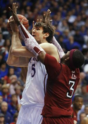 Kansas center Jeff Withey (5) shoots while covered by Temple Owls forward Anthony Lee (3) during the first half of an NCAA college basketball game in Lawrence, Kan., Sunday, Jan. 6, 2013. (AP Photo/Orlin Wagner)