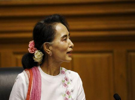 NLD leader Aung San Suu Kyi talks to Shwe Mann, speaker of Myanmar's Union Parliament, during their meeting at the Lower House of Parliament in Naypyitaw