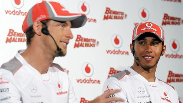 McLaren Formula One drivers Lewis Hamilton (R) and Jenson Button (L) of Britain (Reuters)