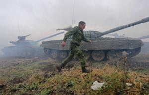 Pro-Russian separatists take part in a military competition…