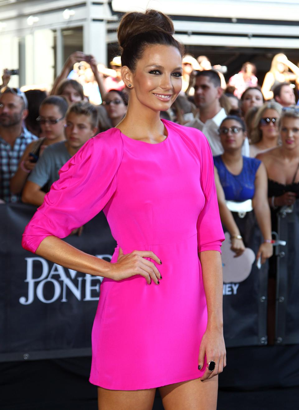 Ricki-Lee Coulter arrives for the Australian music industry Aria Awards in Sydney, Thursday, Nov. 29, 2012. (AP Photo/Rick Rycroft)