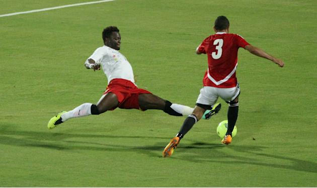 CARIO, Nov. 20, 2013 (Xinhua/IANS) -- Ghana's Sulley Muntar (L) vies for the ball during their 2014 World Cup qualifying second leg playoff soccer match against Egypt in Cario, Egypt, on Nov. 19, 2013