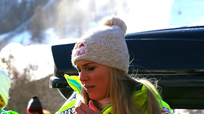 Lindsey Vonn, of United States, her right arm blocked, leaves after falling during an alpine ski women's World Cup Super-G in Val d'Isere, France, Sunday, Dec. 21, 2014. Vonn was looking for a fourth consecutive podium finish and was .01 ahead of Georgl's time on the first split. But after going too tightly into a turn, Vonn went inside on her skis and slid off course, prompting gasps from fans at the bottom of the Oreiller-Killy course. The four-time World Cup champion lay on her back for a few moments before getting up, with no apparent damage to her troublesome right knee. Vonn was looking to move level with Austrian great Annemarie Moser-Proll for all-time wins. (AP Photo/Giovanni Auletta)