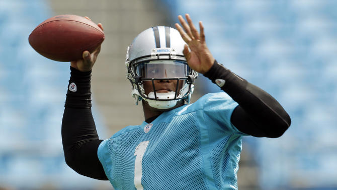 FILE - In this June 14, 2012, file photo, Carolina Panthers quarterback Cam Newton throws a pass during an NFL football practice in Charlotte, N.C. Newton proved his critics wrong last season, showing that he could be an elite NFL quarterback despite just one year at a major college program. Now the question is can he get his team to the playoffs? (AP Photo/Chuck Burton, File)