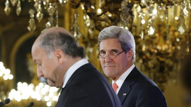 U.S. Secretary of State John Kerry, right, and France's Foreign Minister Laurent Fabius at the Quai d' Orsay, in Paris during their meeting Saturday , Sept. 7, 2013. Kerry traveled to Europe to court international support for a possible strike on the Syrian regime for its alleged use of chemical weapons while making calls back home to lobby Congress where the action faces an uphill battle. (AP Photo/Jacques Brinon)