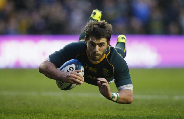 South Africa's Le Roux scores a try against Scotland during their rugby union match in Edinburgh