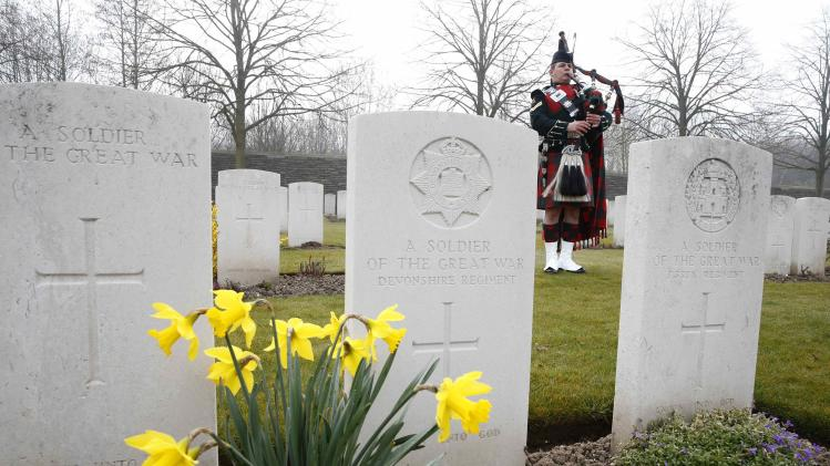 Corporal Gillies of the 2nd Battalion of the Royal Regiment of Scotland plays the bagpipes during a reburial ceremony at the Loos-en-Gohelle Commonwealth war cemetery