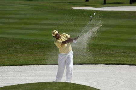 Nirat of Thailand hits out of bunker at first hole during the final round of Volvo Masters of Asia golf tournament in Bangkok