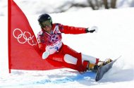 Switzerland's Simon Schoch competes during the men's snowboard parallel giant slalom finals at the 2014 Sochi Winter Olympic Games in Rosa Khutor February 19, 2014. REUTERS/Lucas Jackson