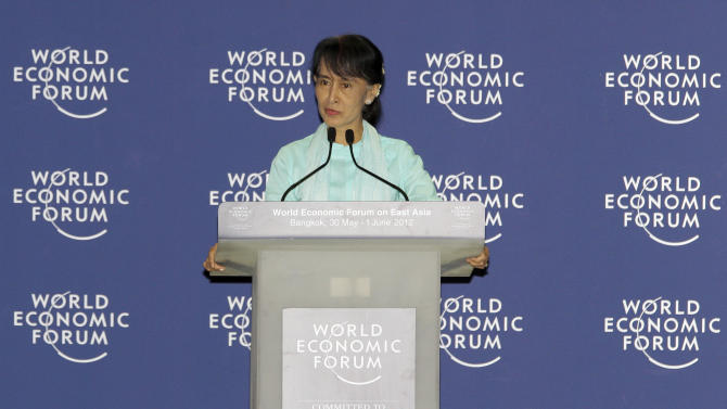 Myanmar opposition leader Aung San Suu Kyi delivers a speech at the World Economic Forum on East Asia in Bangkok Friday, June 1, 2012. (AP Photo/Sakchai Lalit)
