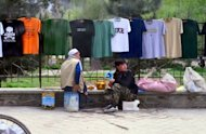 "T-shirts vendors enjoy wait for customers in Kabul on Sunday. A draft agreement on an Afghanistan and US long-term partnership was finalised and initialed on Sunday in Kabul by the heads of the two negotiating delegations in Kabul"", a presidential statement says"