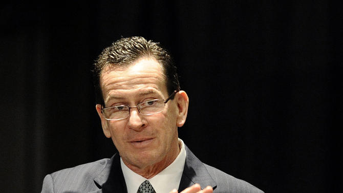 Connecticut Gov. Dannel P. Malloy gestures at a gun violence conference in Danbury, Conn., Thursday, Feb. 21, 2013. The conference was held near Newtown, Conn. where 26 lives were lost in the Sandy Hook Elementary School shooting, was organized by members of the state's congressional delegation is to push President Barack Obama's gun control proposals. (AP Photo/Jessica Hill)