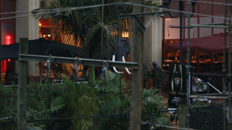 Soldiers from the Kenya Defence Forces are seen entering the Westgate Shopping Centre in the capital Nairobi