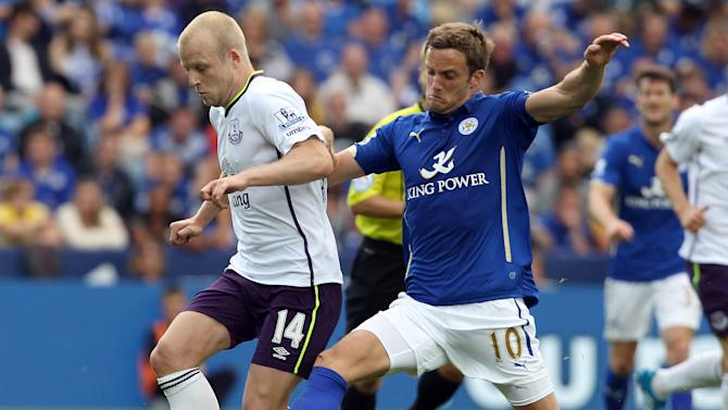 Leicester City's midfielder Andy King (R) vies for the ball with Everton's striker Steven Naismith during their English Premier League football match on August 16, 2014
