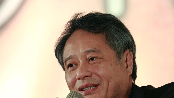 "Taiwanese director Ang Lee answers questions during a press conference announcing their new film ""Life of Pi,"" in Taipei, Taiwan, Wednesday, Nov. 7, 2012. ""Life of Pi"" is an upcoming 3D adventure film based on the 2001 novel of the same name by Yann Martel, staring Suraj Sharma and directed by Lee. (AP Photo/Wally Santana)"