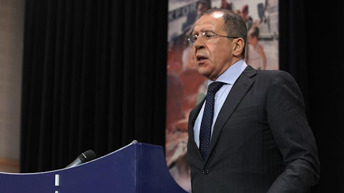 Russia's Foreign Minister Sergey Lavrov speaks at a media conference during a meeting of NATO foreign ministers at NATO headquarters in Brussels on Tuesday, Dec. 4, 2012. NATO foreign ministers are expected to approve Turkey's request for Patriot anti-missile systems to bolster its defense against possible strikes from neighboring Syria. (AP Photo/Yves Logghe)