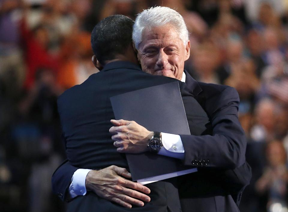 Former President Bill Clinton hugs President Barack Obama after addressing the Democratic National Convention in Charlotte, N.C., on Wednesday, Sept. 5, 2012. (AP Photo/Jae C. Hong)