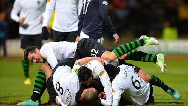 Celtic celebrate after Georgios Samaras, hidden, scored their opening goal against Dundee