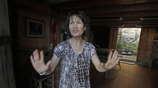 In this Aug. 20, 2012 photo, Cheng Yu-lan, 55, talks about the massive investments in a casino proposed on Beigan in the Matsu island group off northern Taiwan. In early July some 3,000 Matsu residents voted 57 to 43 to permit casino gambling. Their votes were clearly influenced by the promises of not only a casino, but also a tourist resort, expanded airport, roadway infrastructure, a university, and perhaps most alluring of all, a monthly payment of 80,000 New Taiwan dollars ($2,666) for every resident. (AP Photo/Wally Santana)