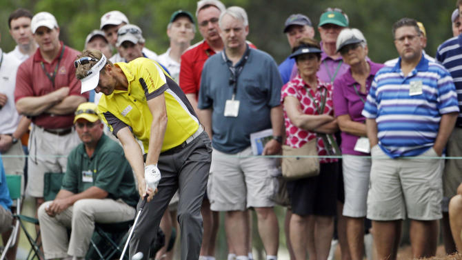 David Lynn, of England, takes his second shot on the first hole during the first round of the Masters golf tournament Thursday, April 11, 2013, in Augusta, Ga. (AP Photo/Darron Cummings)