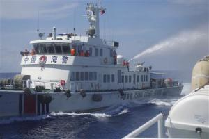 A Chinese ship uses water cannon on a Vietnamese Sea Guard ship on the South China Sea near the Paracels islands