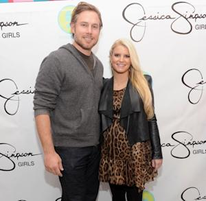 Jessica Simpson and Eric Johnson attend the launch of Jessica Simpson Girls at Dylan's Candy Bar on December 1, 2011 in New York City -- Getty Images