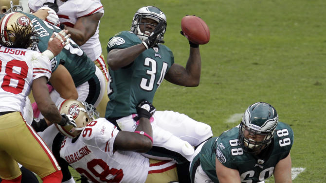 Philadelphia Eagles running back Ronnie Brown fumbles the ball as he is tackled by San Francisco 49ers outside linebacker Parys Haralson (98) in the first half of an NFL football game Sunday, Oct. 2, 2011 in Philadelphia. San Francisco recovered the fumble. (AP Photo/Julio Cortez)