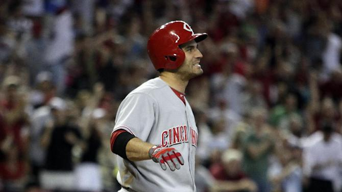 Cincinnati Reds Joey Votto drops his bat after striking out in the eighth inning during a baseball game against the Arizona Diamondbacks, Saturday, June 22, 2013, in Phoenix. (AP Photo/Rick Scuteri)