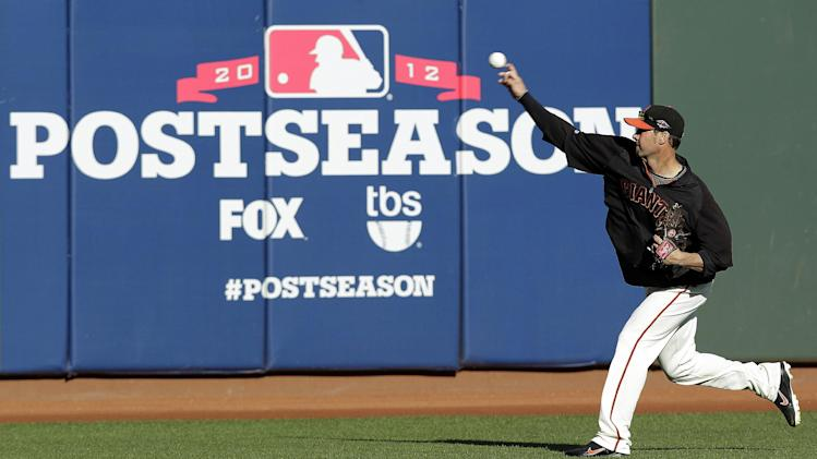 San Francisco Giants' Ryan Vogelsong pitches during a voluntary workout in preparation for Game 6 of the National League baseball championship series against the St. Louis Cardinals, Saturday, Oct. 20, 2012 in San Francisco. Vogelsong is scheduled to be the starting pitcher for Sunday's game. (AP Photo/Ben Margot)