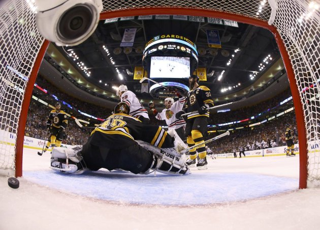 Bruins goalie Rask and teammate Chara reacts as Blackhawks' Bickell celebrates teammate Seabrook's overtime goal in Game 4 of their NHL Stanley Cup Finals hockey series in Boston