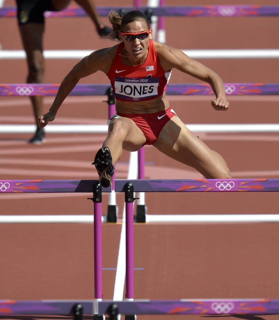 United States' Lolo Jones competes in a women's 100-meter hurdles heat during the athletics in the Olympic Stadium at the 2012 Summer Olympics, London, Monday, Aug. 6, 2012.(AP Photo/Martin Meissner)