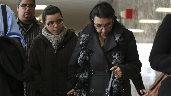Rosemary, right, and Becky Hernandez, the wife and daughter of Pedro Hernandez leave Manhattan criminal court, Wednesday, Dec. 12, 2012 in New York. Pedro Hernandez is charged with killing a 6-year-old New York City boy in 1979 has pleaded not guilty to murder despite police saying he confessed to the crime. The lawyer for Hernandez  says his defense will revolve around his mental state, but he isn't pursuing an insanity defense. (AP Photo/Mary Altaffer)
