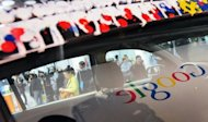 Google logo is reflected in a window of a car in 2010. The state of Nevada has issued a license plate giving Google&#39;s self-driving car the green light to travel along public roads