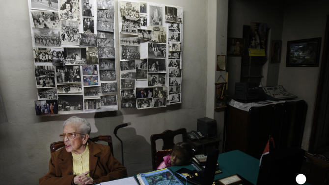 """In this Nov. 26, 2012 photo, journalist and radio host Maria Julia Venegas , better known as Maruja Venegas, 97, speaks during an interview at her home in Lima, Peru. Venegas who began broadcasting """"Radio Club Infantil,"""" a show for Peru's children in the golden age of radio and World War II, has earned a citation from Guinness World Records as the globe's longest-running radio personality. (AP Photo/Karel Navarro)"""