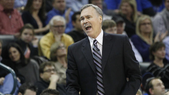 Los Angeles Lakers coach Mike D'Antoni reacts to an official's call during the second quarter of an NBA basketball game against the Oklahoma City Thunder in Oklahoma City, Friday, Dec. 7, 2012. (AP Photo/Sue Ogrocki)