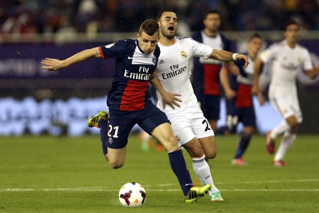 Real Madrid's Jese challenges Paris St Germain's Lucas Digne during their friendly soccer match at Khalifa stadium in Doha