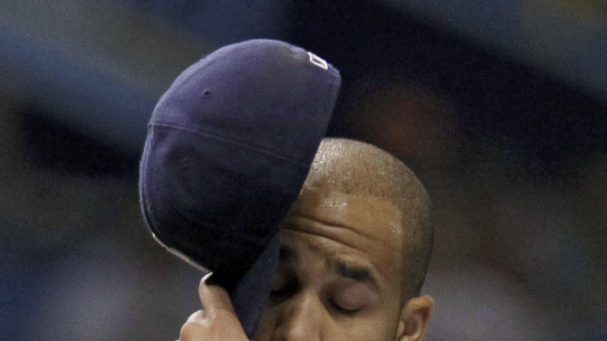 Tampa Bay Rays starting pitcher David Price wipes his forehead as he struggles against the New York Mets during the fifth inning of an interleague baseball game Wednesday, June 13, 2012, in St. Petersburg, Fla. (AP Photo/Chris O'Meara)