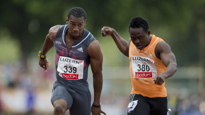 Jamaica's Yohan Blake, left, and Nigeria's Egwero Ogho-Ogene compete during the men's 100m race at the International Athletics Meeting in Lucerne, Switzerland, Tuesday, July 14, 2015. (Urs Flueeler/Keystone via AP)