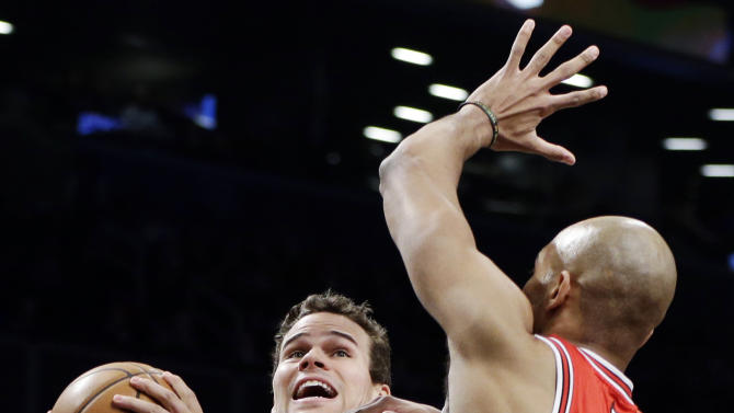 Chicago Bulls forward Taj Gibson (22) defends as Brooklyn Nets forward Kris Humphries (43) looks for a shot in the first half of Game 2 of their first-round NBA basketball playoff series, Monday, April 22, 2013, in New York. (AP Photo/Kathy Willens)