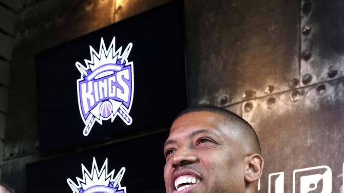 Sacramento Mayor Kevin Johnson smiles during a news conference, Monday, April 29, 2013, in Sacramento, Calif. The NBA's relocation committee voted unanimously Monday to recommend that owners reject the application for the Sacramento Kings basketball team to relocate to Seattle, the latest _ and by far the strongest _ in a long line of cities that almost landed the franchise. (AP Photo/Rich Pedroncelli)