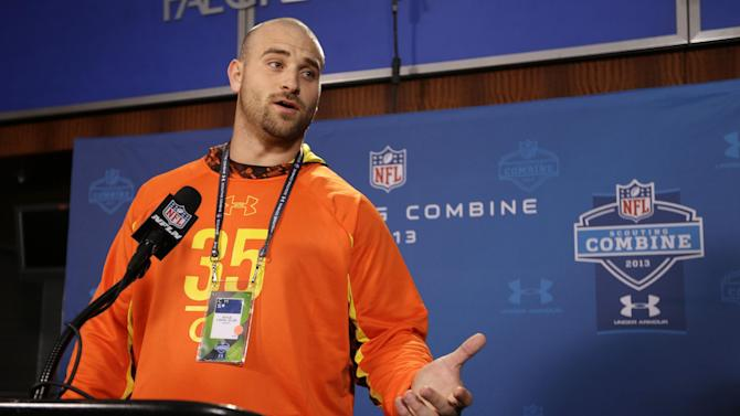 Oregon offensive lineman Kyle Long answers a question during a news conference at the NFL football scouting combine in Indianapolis, Thursday, Feb. 21, 2013. (AP Photo/Michael Conroy)