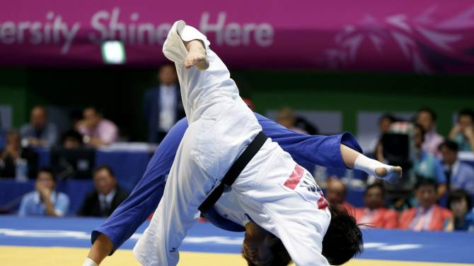Japan's Arai competes with South Korea's Kim in their women's team gold medal judo contest at Dowon Gymnasium during the 17th Asian Games in Incheon