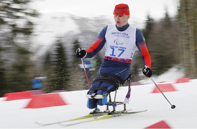Aleksandr Davidovich of Russia races to win the bronze medal in the men's 15-kilometer cross country ski sitting event at the 2014 Winter Paralympics, Sunday, March 9, 2014, in Krasnaya Polyana, R