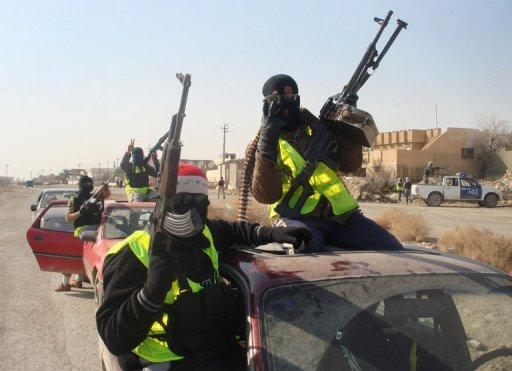 "Armed Sahwa or ""Awakening"" militiamen patrol the northern Iraqi city of Samarra, on August 21, 2010. Iraqi officials say they will raise the salaries of Sunni militiamen who fought Al-Qaeda during the country's brutal sectarian war, the latest bid to appease mostly-Sunni anti-government rallies"