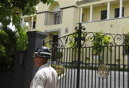 A police officer walks past the Apostolic Nunciature in Santo Domingo