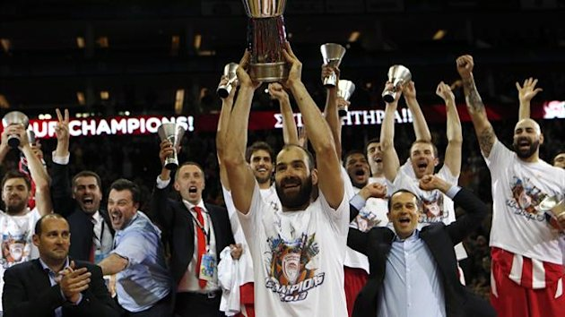 Vassilis Spanoulis receives the MVP trophy after their Euroleague Basketball Final defeat of Real Madrid (Reuters)